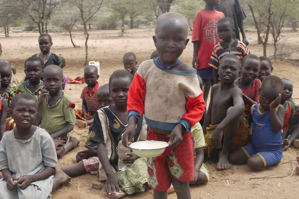 A preschool boy with his porridge