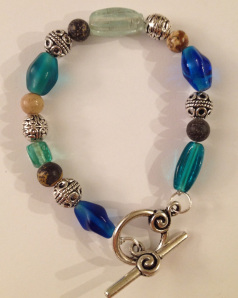 Win this handmade blue glass, jasper, and Tibetan silver bracelet in LONDON LEGENDS colors!